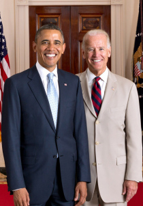 A rare photo of President Barack Obama and Vice President Joseph Biden engaged in the White House Whitest Smile contest. Image source: Wikipedia